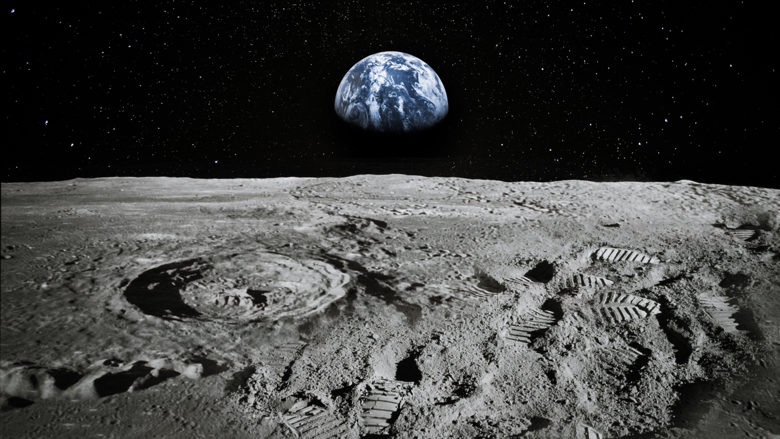 View of the moon limb with the Earth rising on the horizon