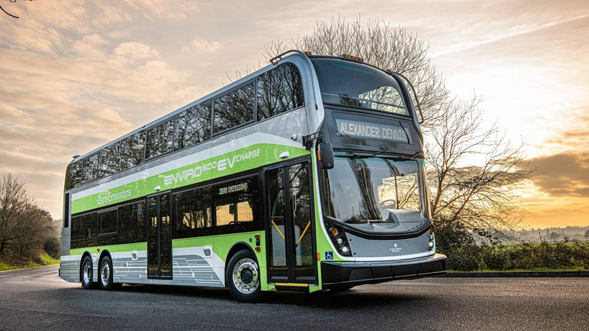 A double-decker bus in green and white.