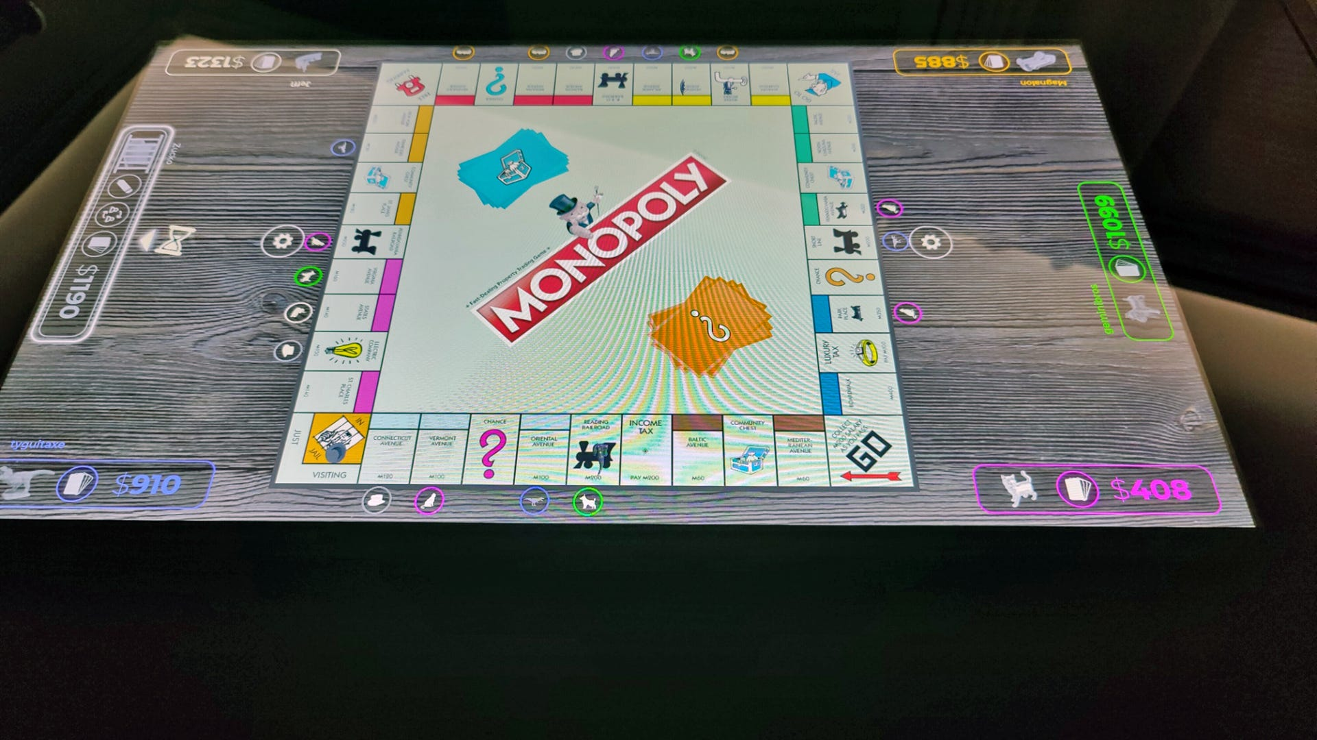 A game of Monopoly on a digital tablet