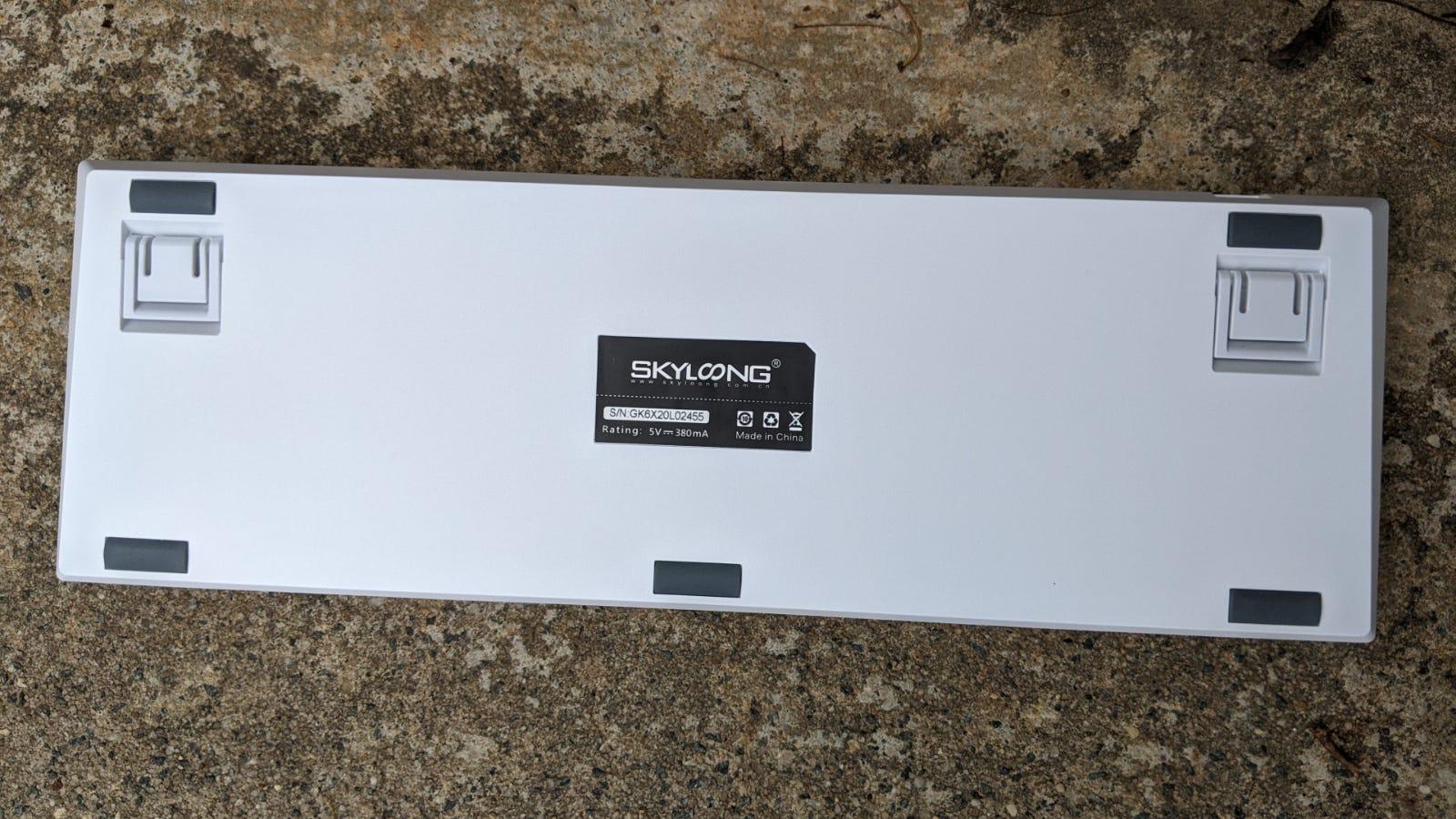 Epomaker GK96S turned upside down on concrete step