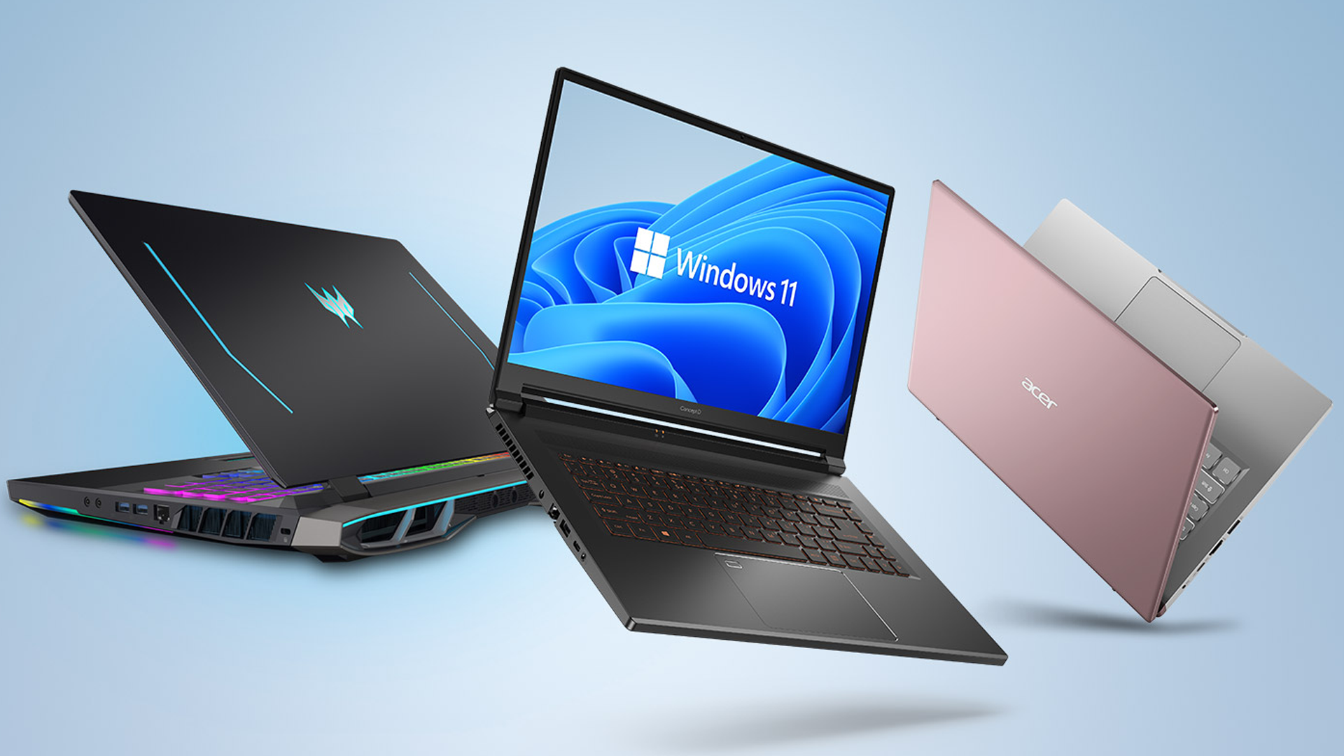 Three laptops on a light blue screen on with Windows 11 on it.