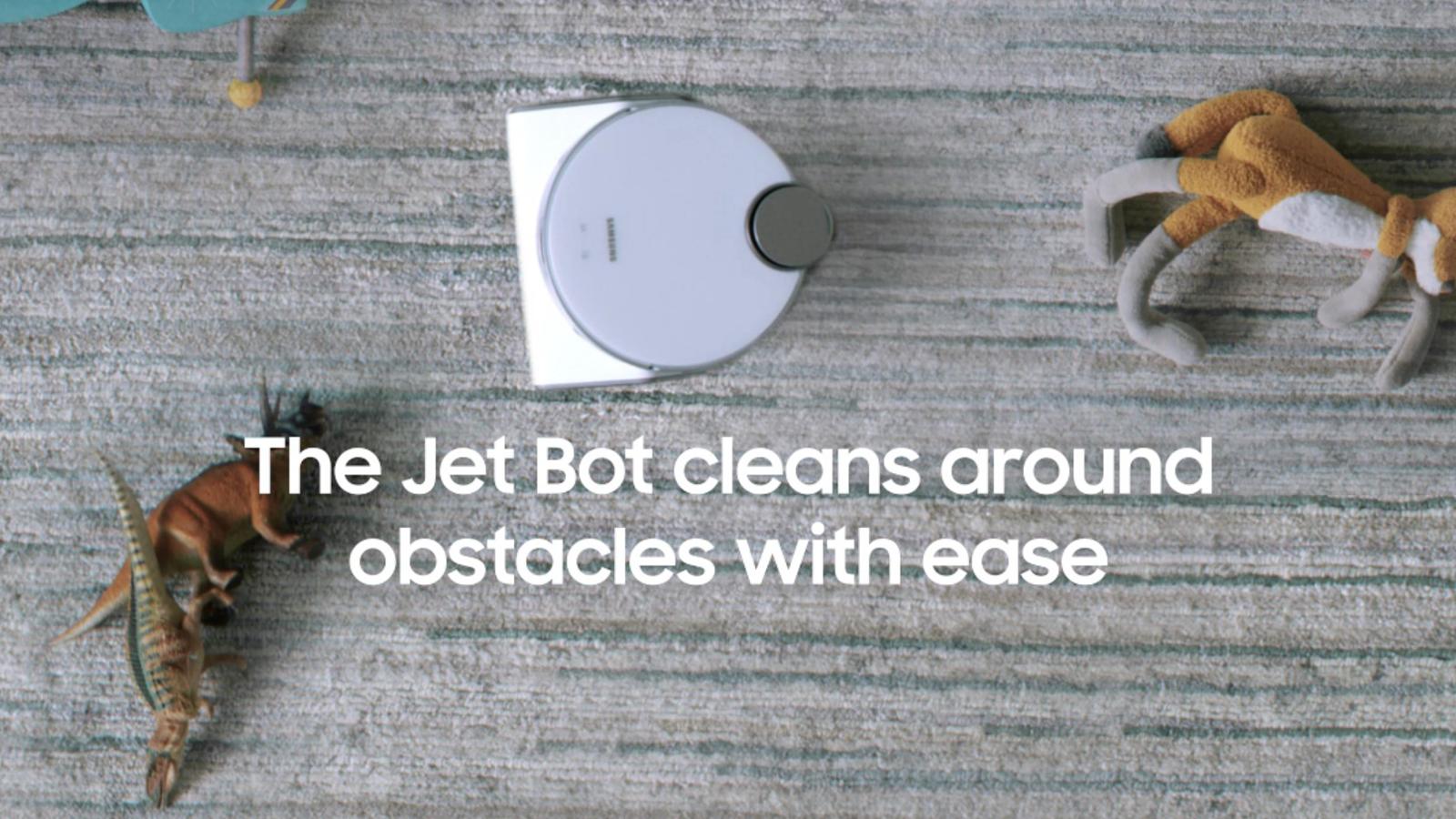 The Jet Bot AI+ navigating around toys on carpet