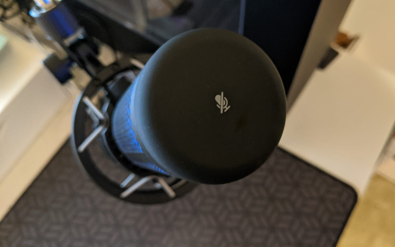 """Close-up of HyperX QuadCast S """"tap-to-mute"""" pad"""