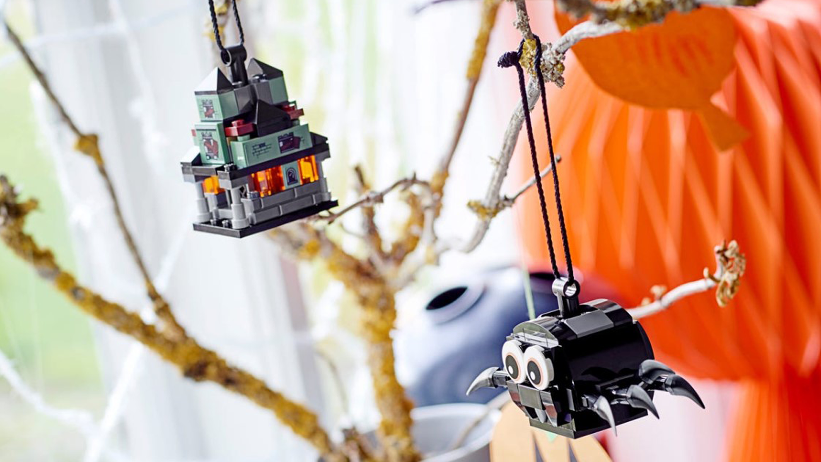 LEGO Spider & Haunted House Pack hanging from tree with other seasonal decor