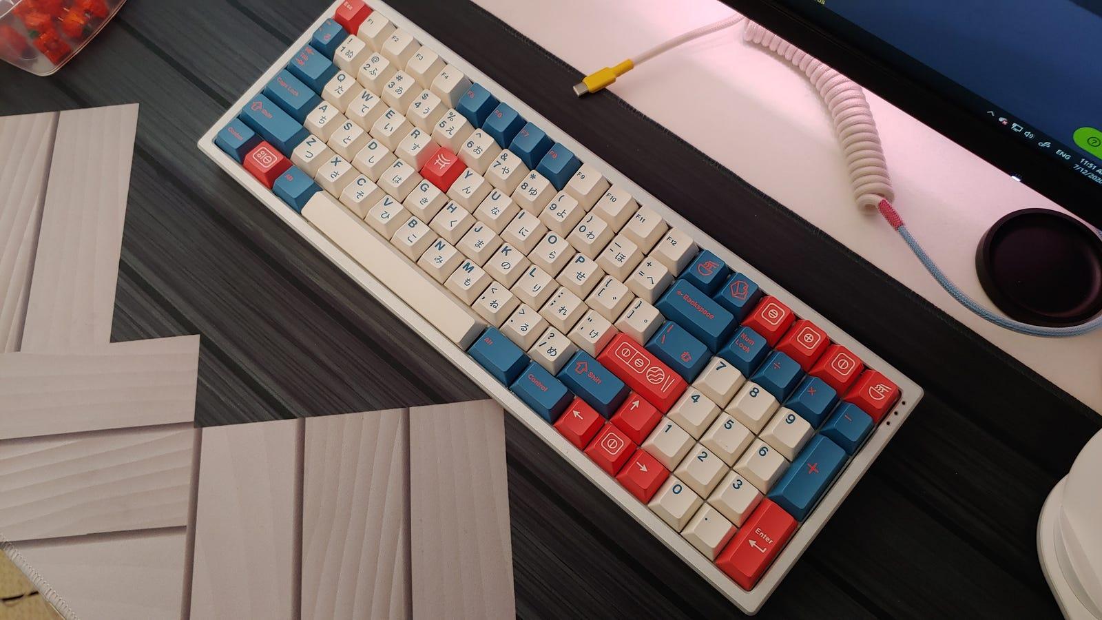 96% mechanical keyboard on top of black deskmat