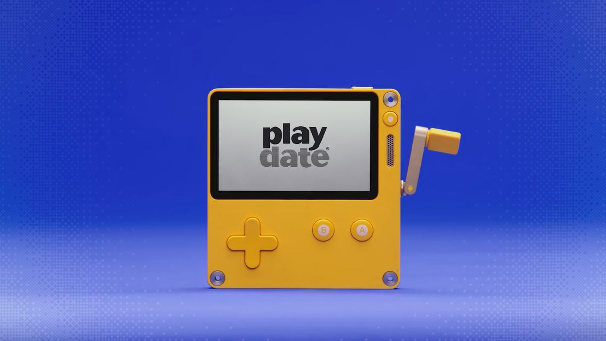 Playdate console against fun blue background