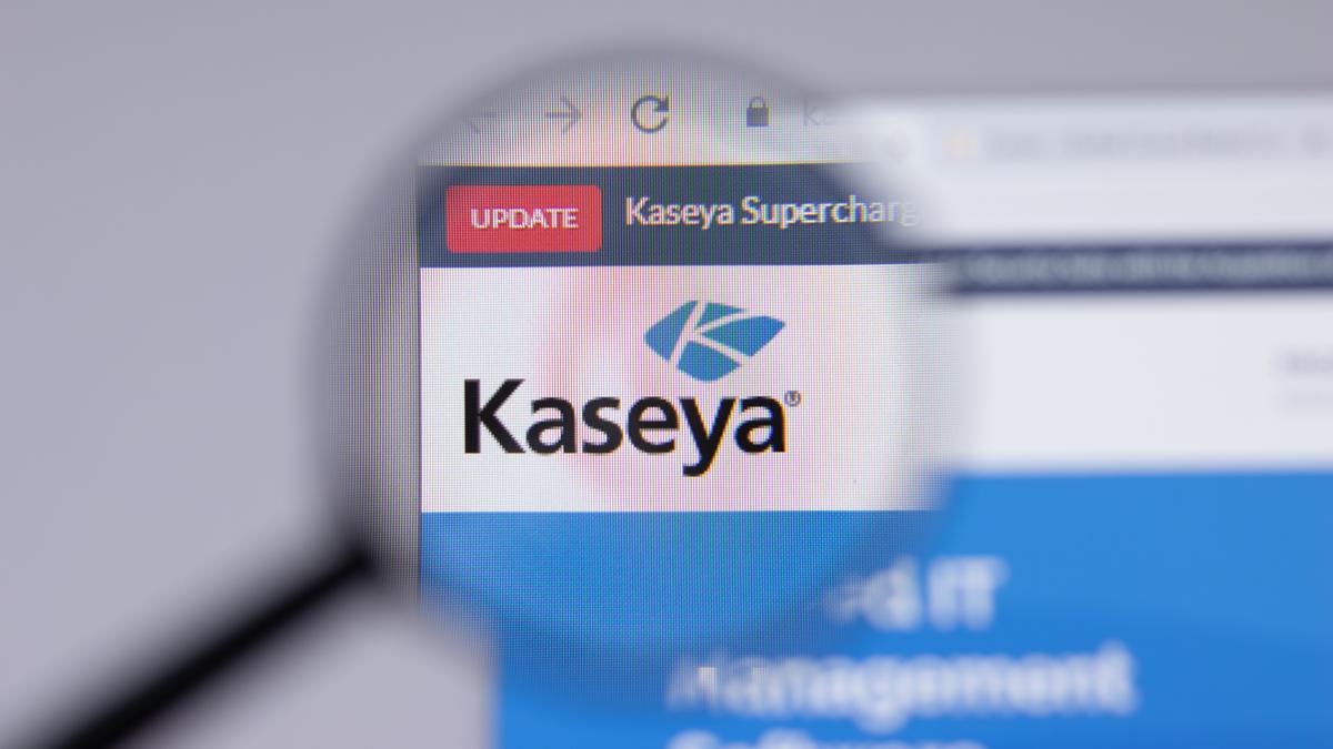 A magnifying glass over the Kaseya logo.