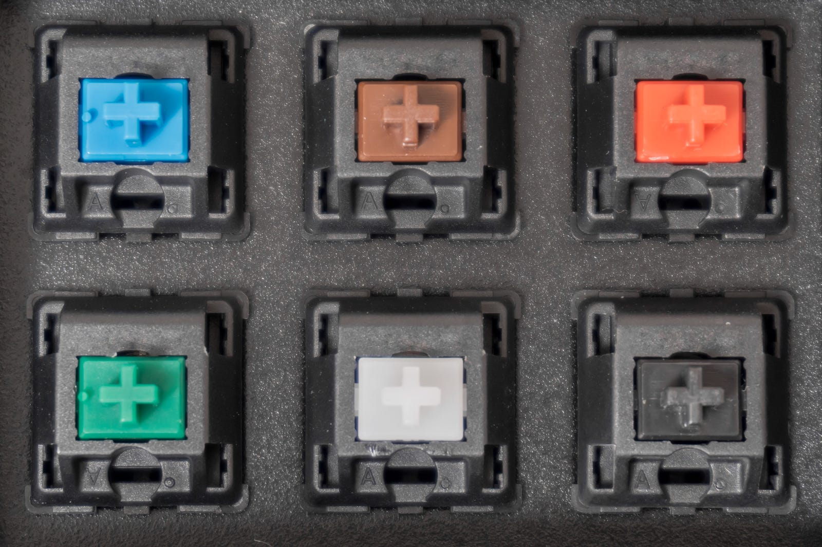 Handful of mechanical switches stored in foam display