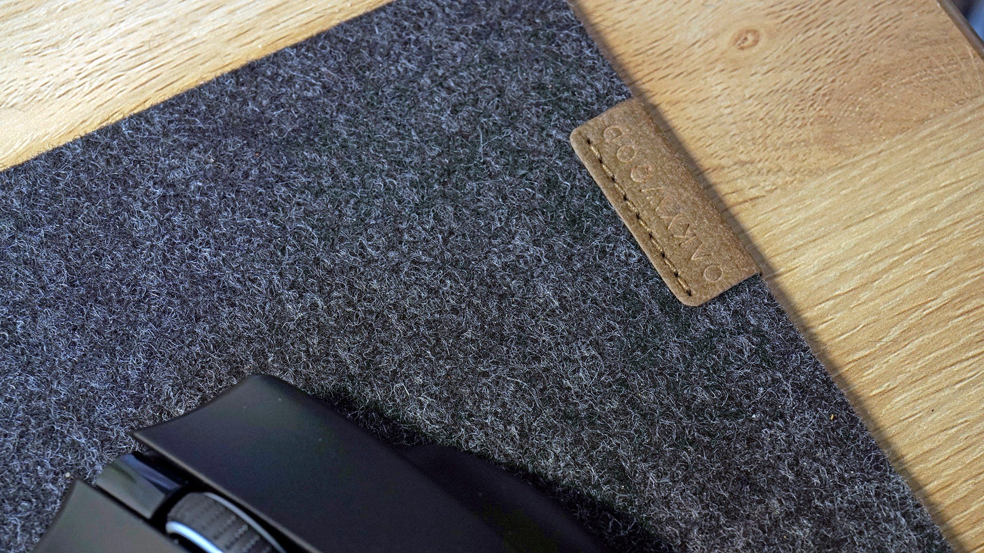 Oakywood leather tag on felt desk mat