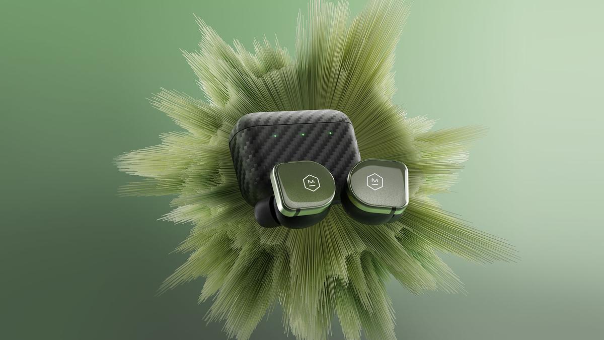 Master & Dynamic MW08 Sport buds against splashy green background