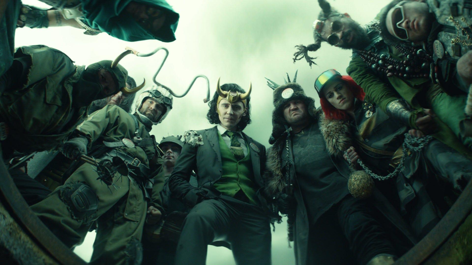 Many Lokis standing over a manhole.