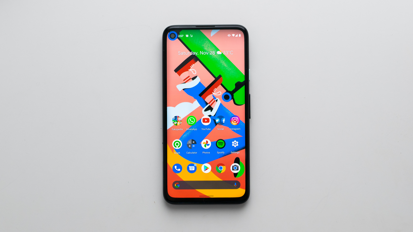 Top view of Google Pixel phone against light grey background