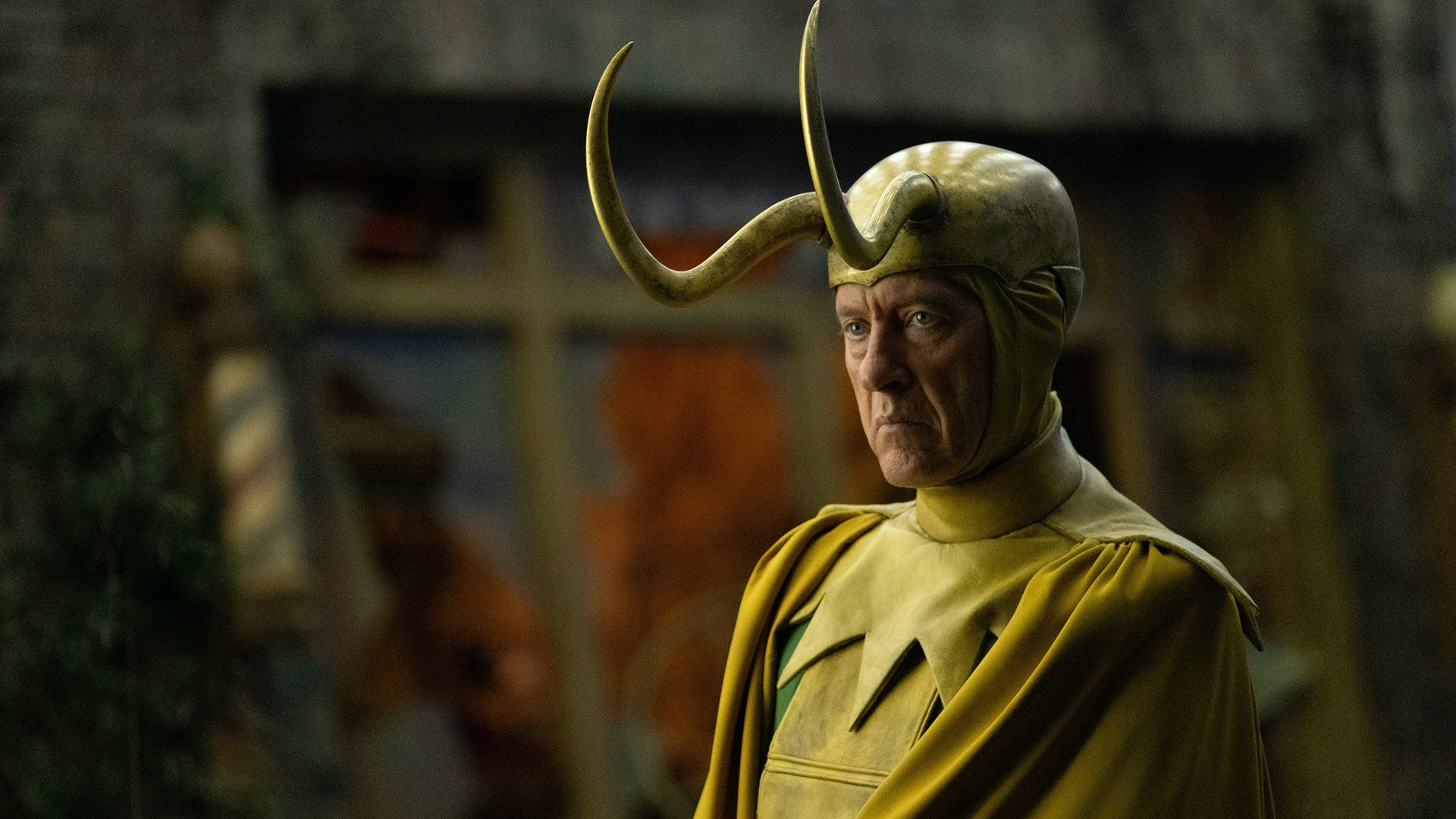 Classic Loki in a yellow and green costume