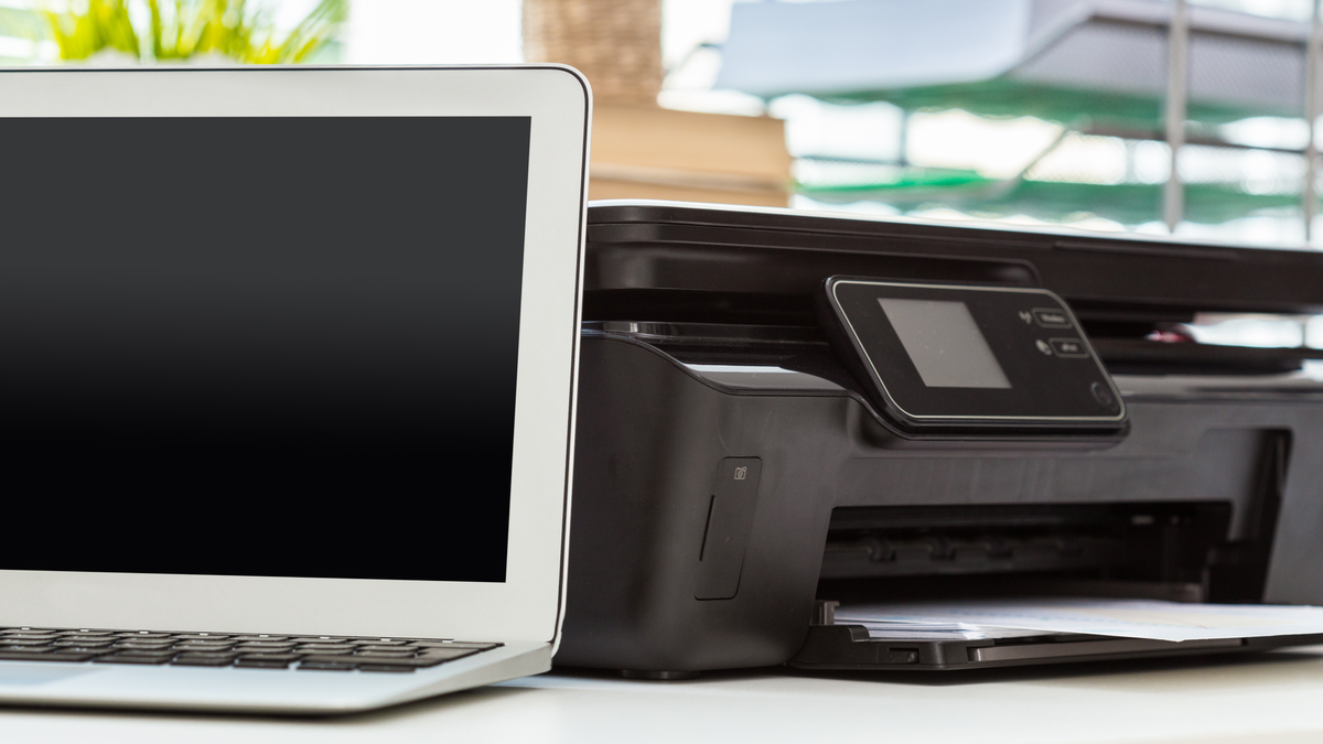 Printer and computer on office table