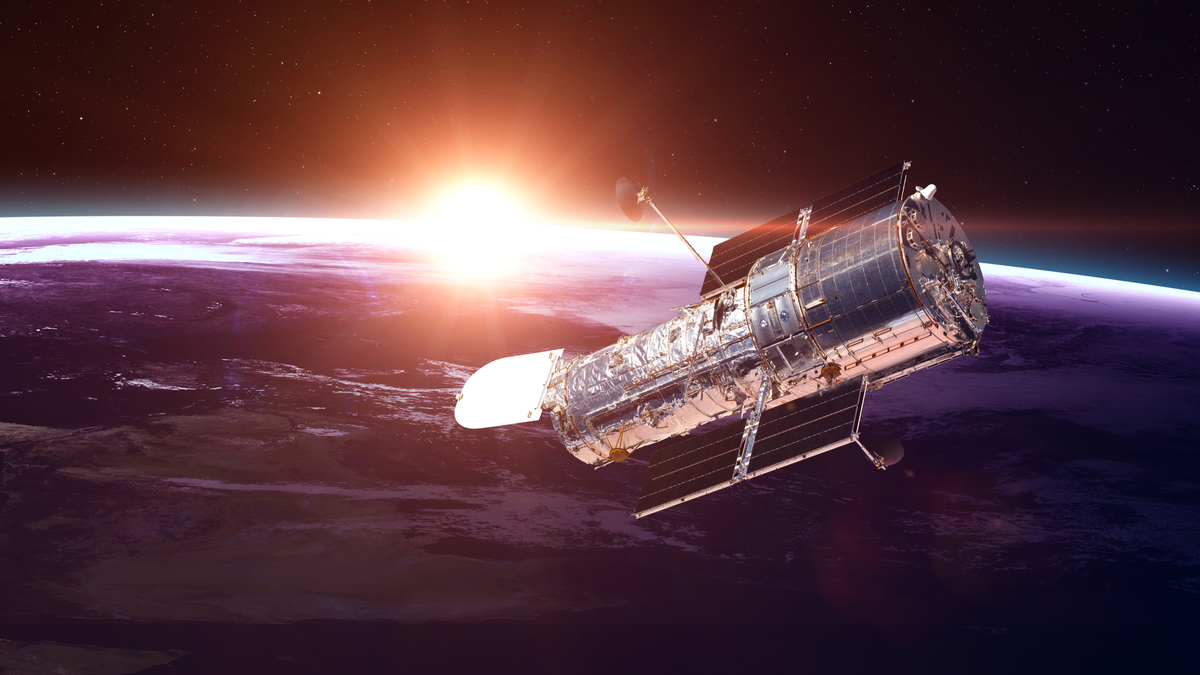 The Hubble Space Telescope in orbit over Earth. Elements of this image furnished by NASA