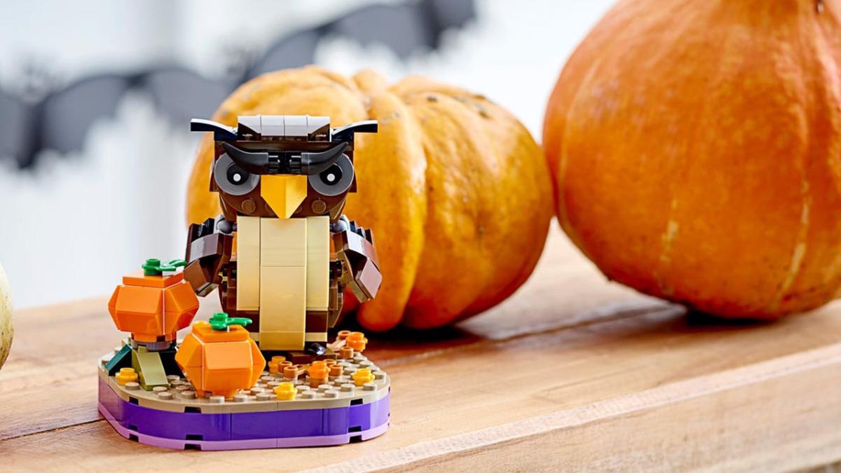 LEGO Halloween Owl set next to pumpkins and other seasonal decor