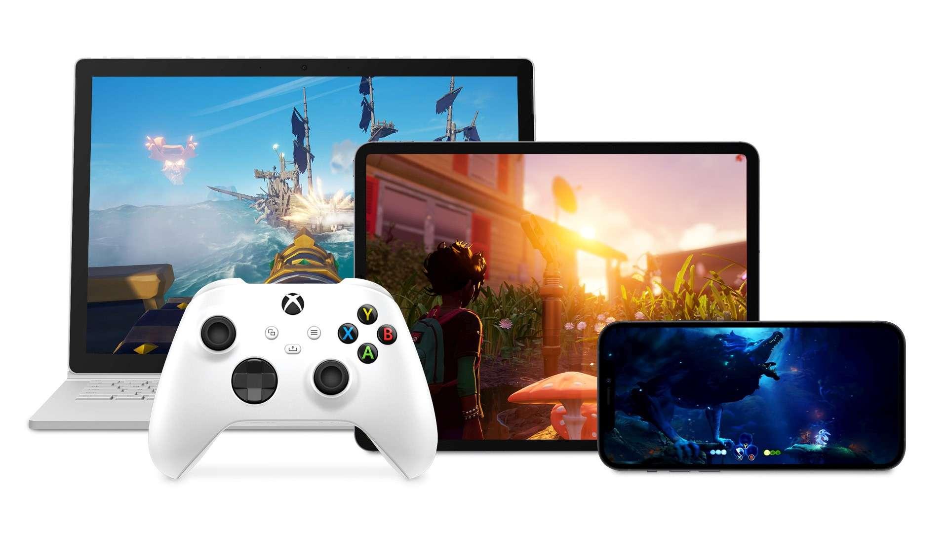 Un controller Xbox davanti a un laptop, un iPad e un telefono Android che giocano tutti con i giochi Xbox