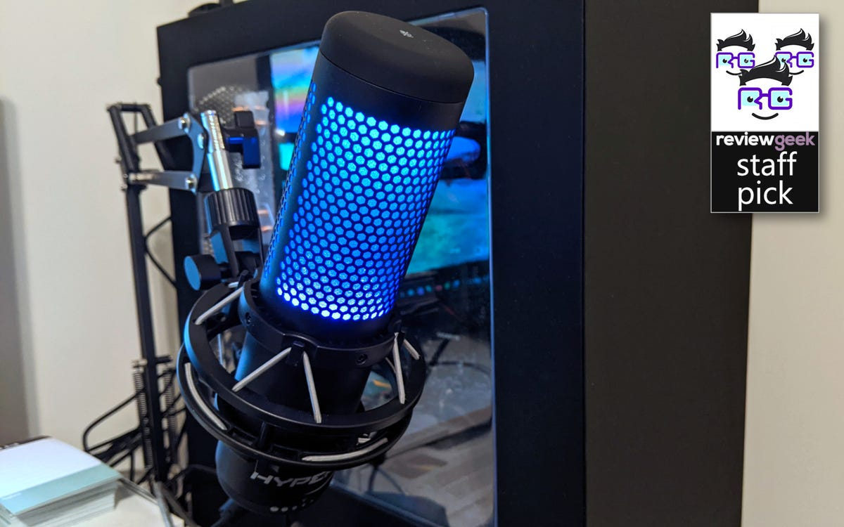 HyperX QuadCast S on a mic arm in front of a computer