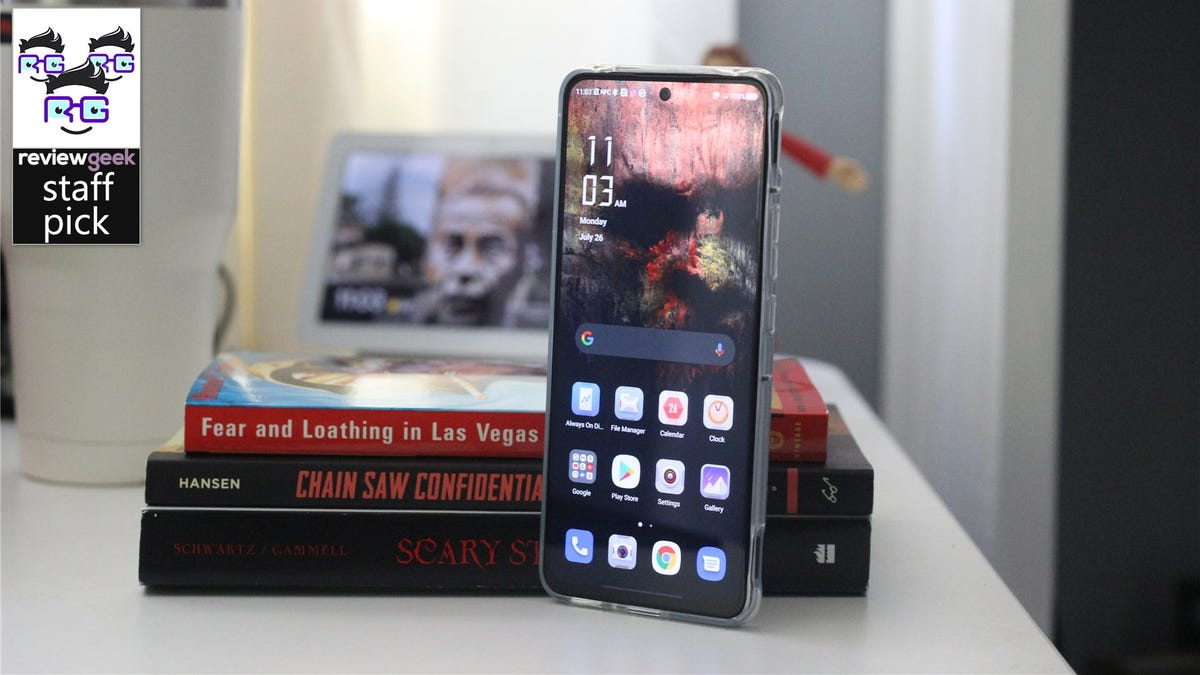 The Red Magic 6R propped up against some books on a desk