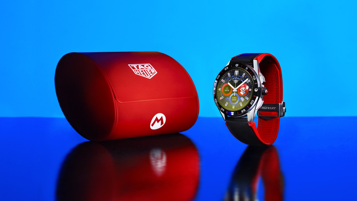 View of TAG Heuer x Super Mario Wear OS watch and case against blue background