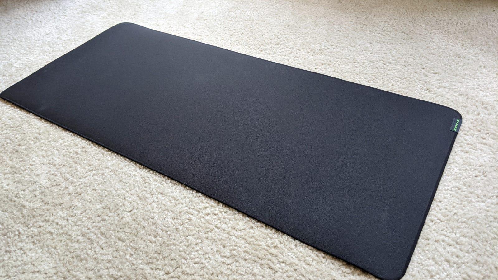 Razer Strider XXL mousepad on carpeted floor