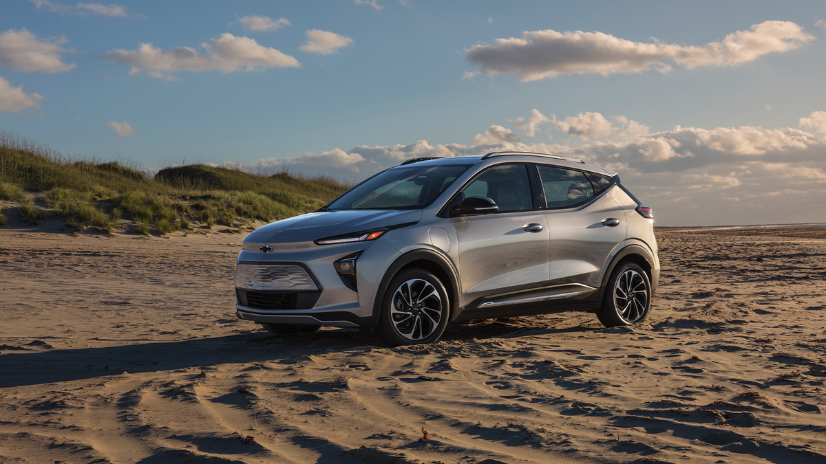 A photo of the 2022 Chevy Bolt at a beach.