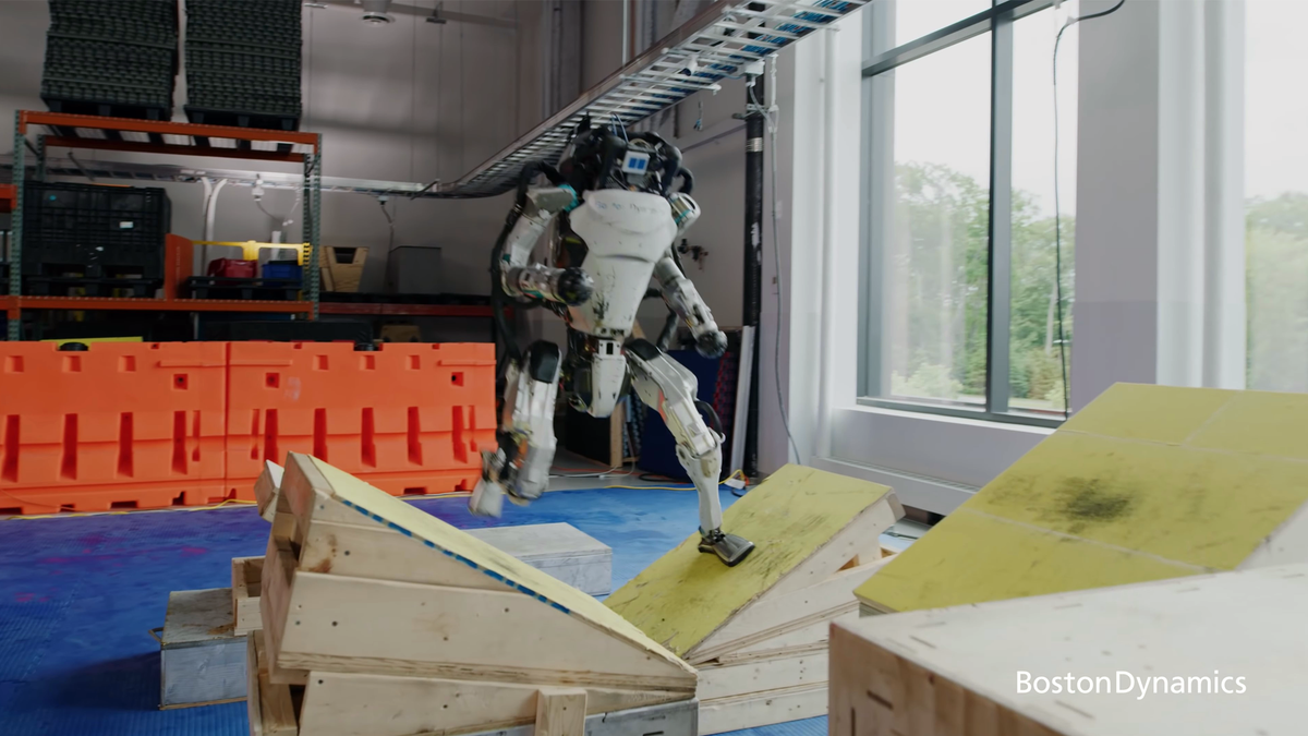 Boston Dynamics Atlas robot running obstacle course