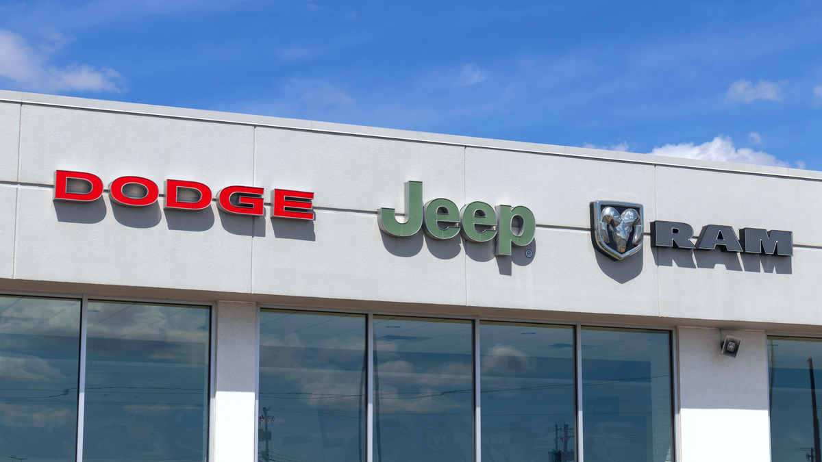 Dodge, Jeep, and Ram logos on dealership building