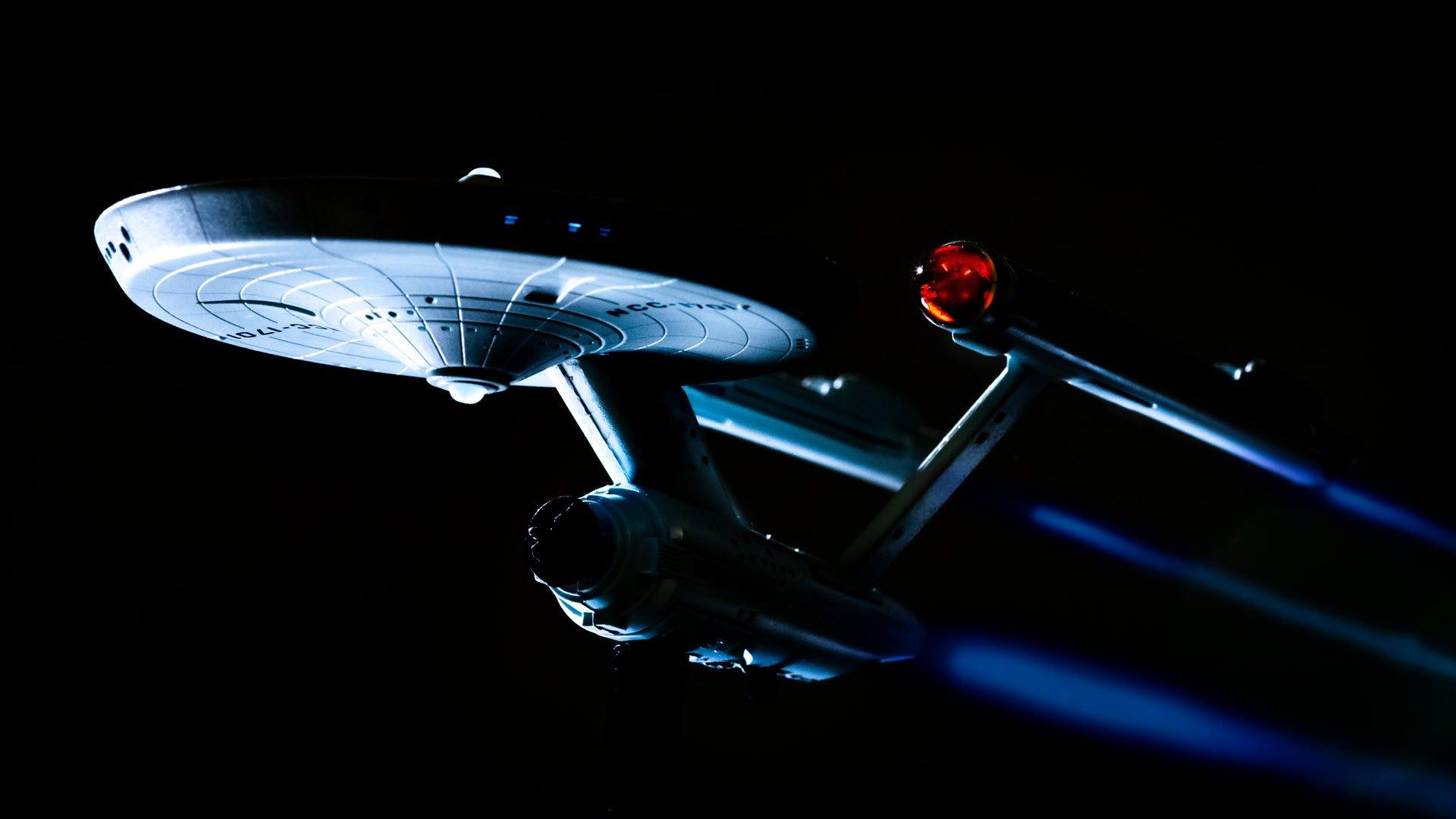 The Enterprise from 'Star Trek' warping through space.