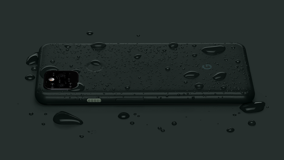 The Google Pixel 5a covered in drops of water.