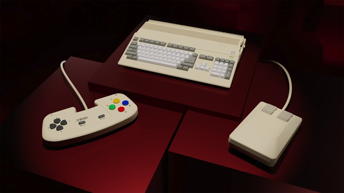 Retro Games' THEA 500 on a red table alongside the recreated 2-button mouse and Amiga CD32 gamepad.