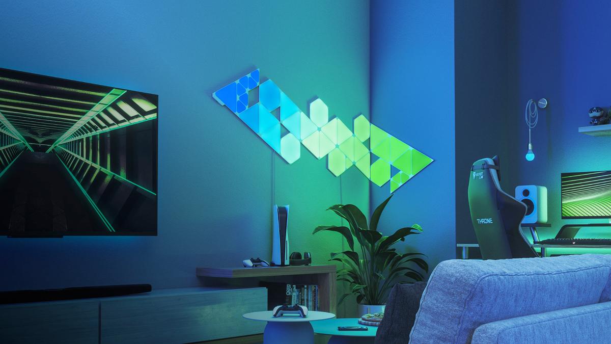 A set of Nanoleaf Shapes panels on a living room wall.