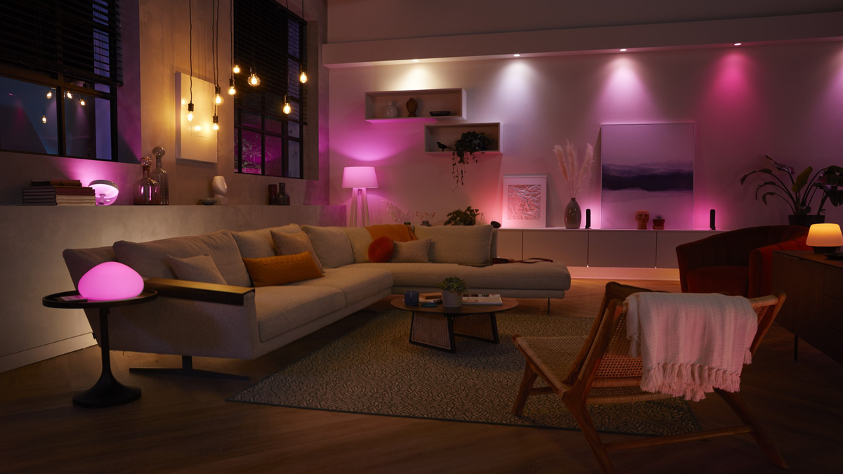 Multiple Philips Hue E26 bulbs in fixtures and lamps throughout a large modern living room