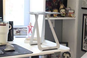 The VariDesk Portable Laptop Stand on a desk, no laptop, side angle