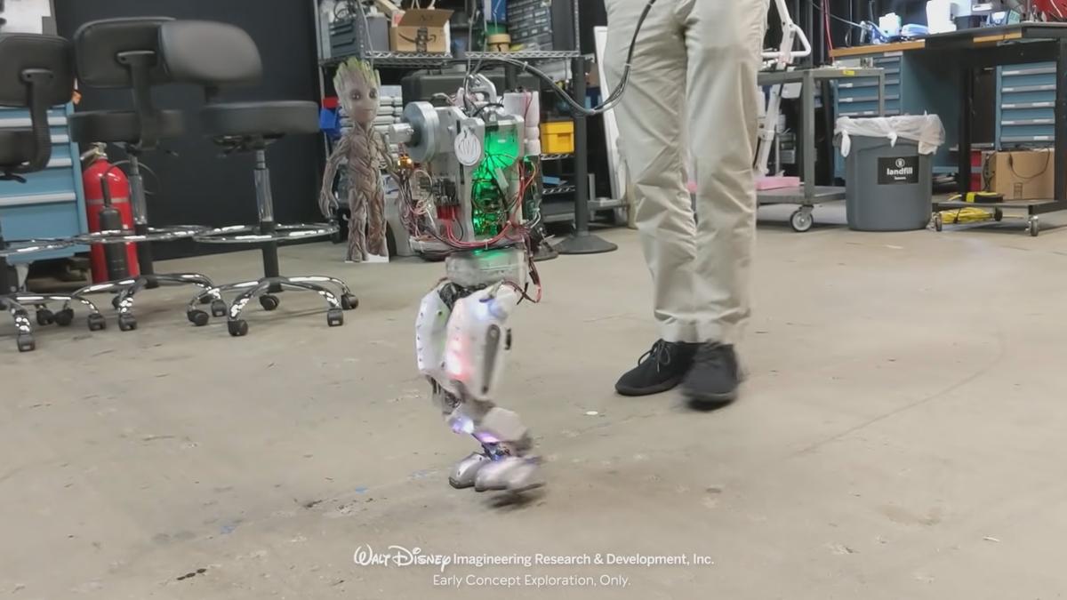 Walt Disney Imagineering Research & Development, Inc. photo of walking animatronics in their lab.
