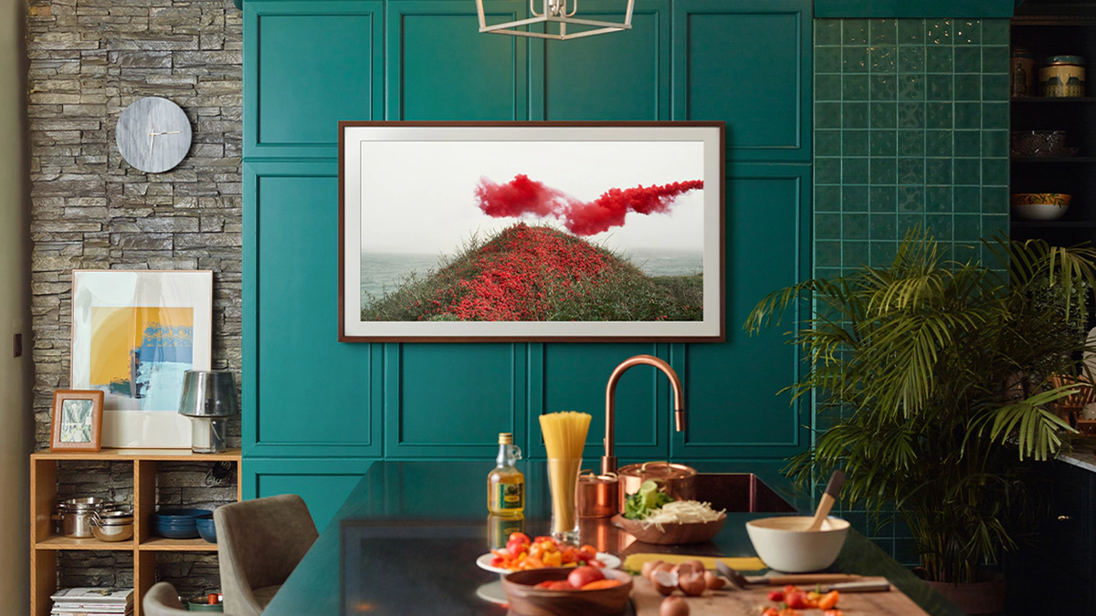 A photo of the Frame TV playing video of a bright red feild.