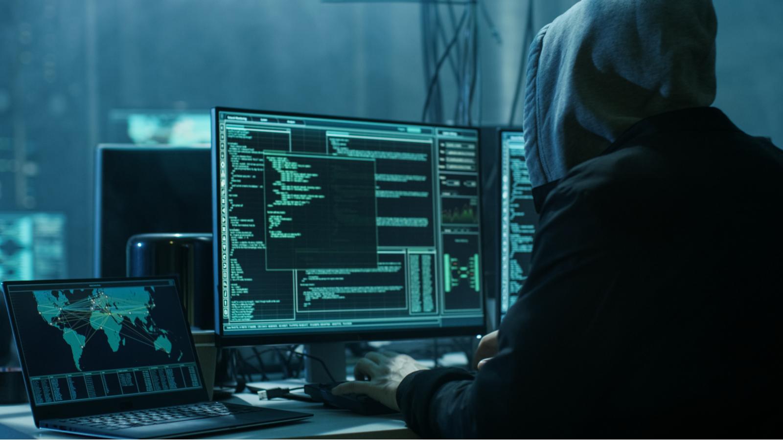 Dangerous hooded hacker breaks into data server