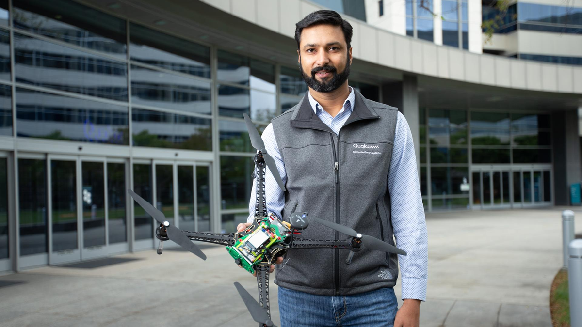 A man holding the Qualcomm reference drone.