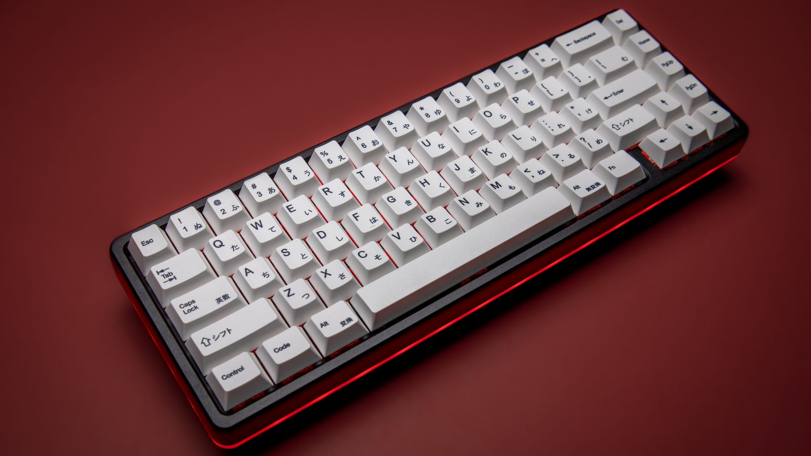65% mechanical keyboard on red backdrop
