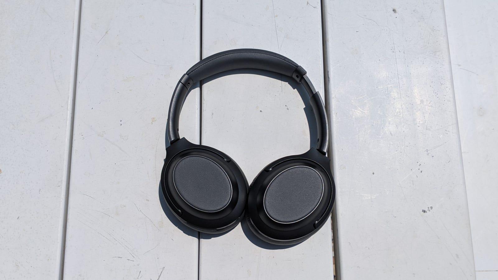 Monoprice BT-600ANC headphones on a white picnic table