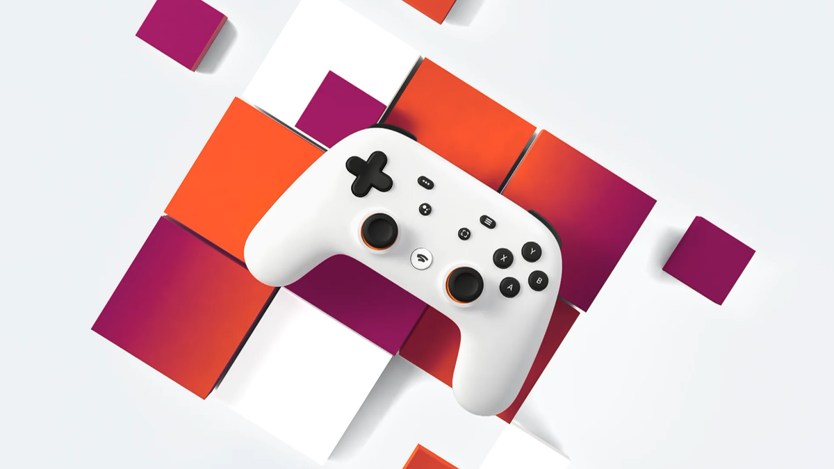 The Google Stadia controller over a red and white background.