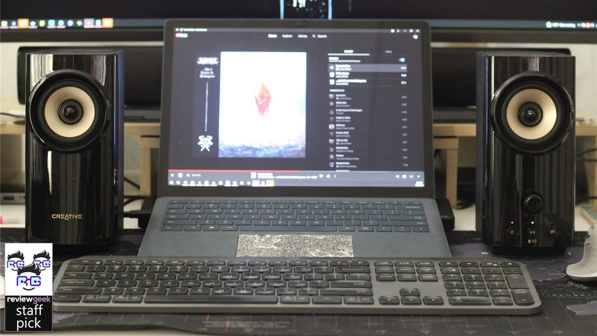 The Creative T60 speakers flanking a Surface Laptop 3