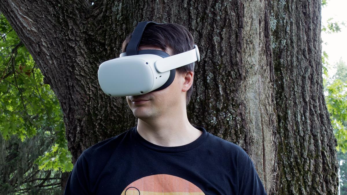 A man wearing an Oculus Quest 2 headset