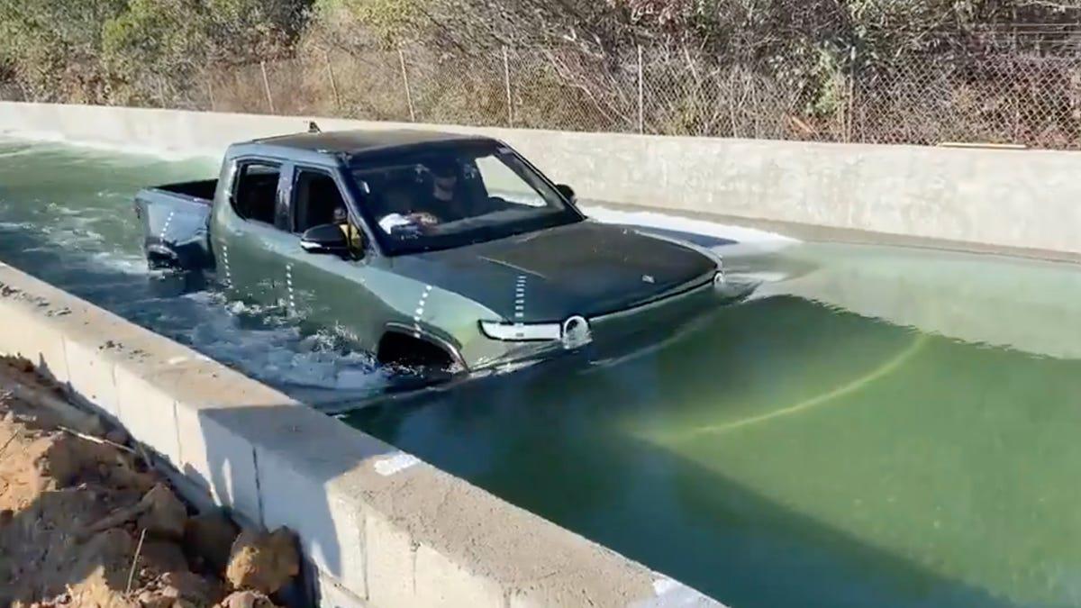 Rivian R1T truck in water