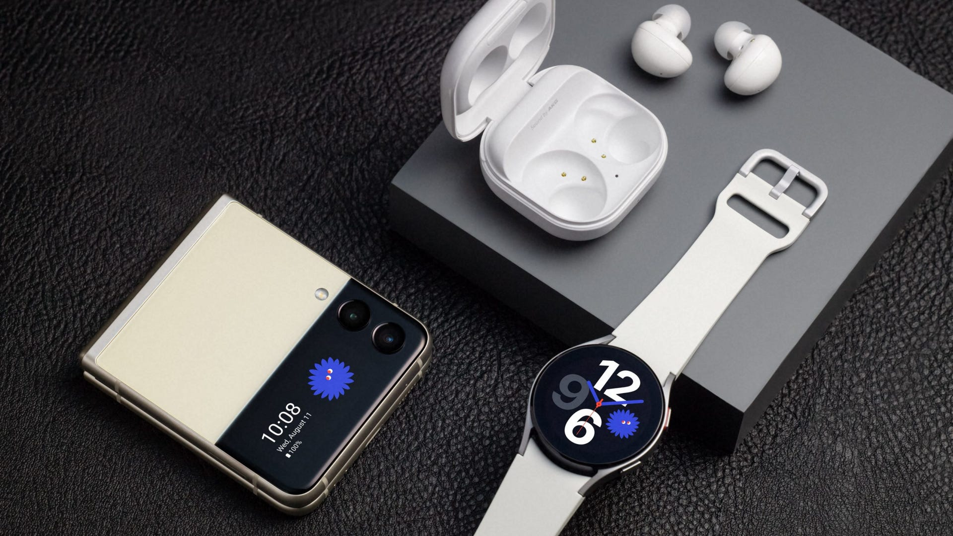 A photo of the Samsung Flip 3, Watch 4, and Buds 2