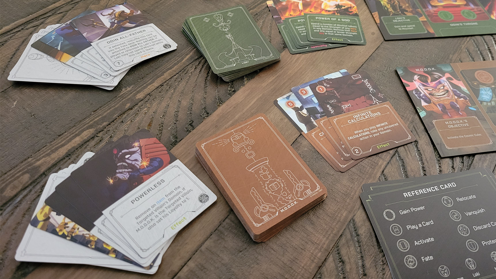 Cards from each villain deck, showing the art on the back and a few face cards