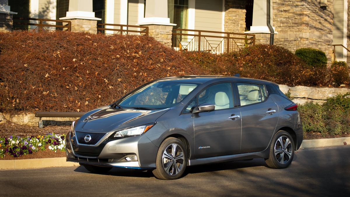 Nissan Leaf parked outside nice building with landscaping