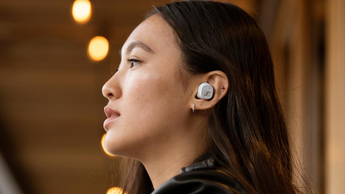 Sennheiser CX Plus wireless earbuds in white.