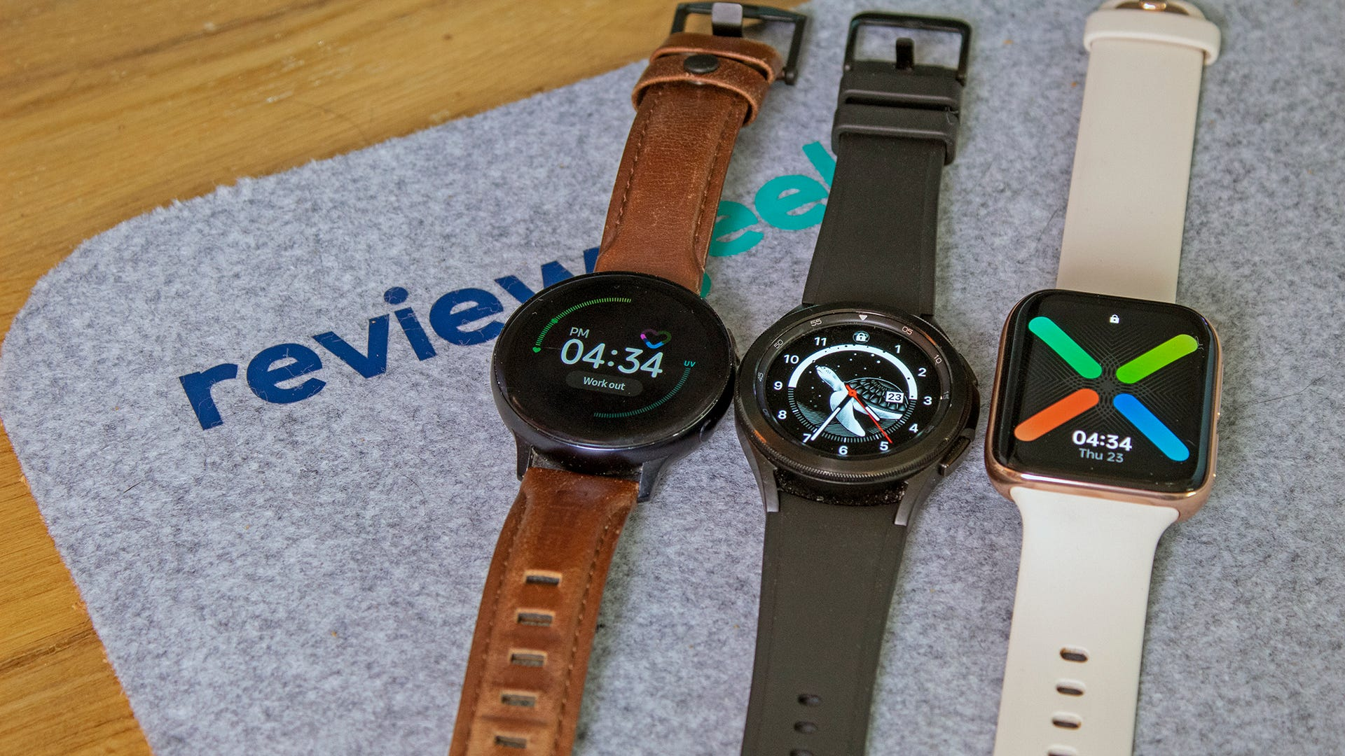 A Galaxy Watch Active 2 next to a Galaxy Watch 4, next to an Oppo Wear OS watch