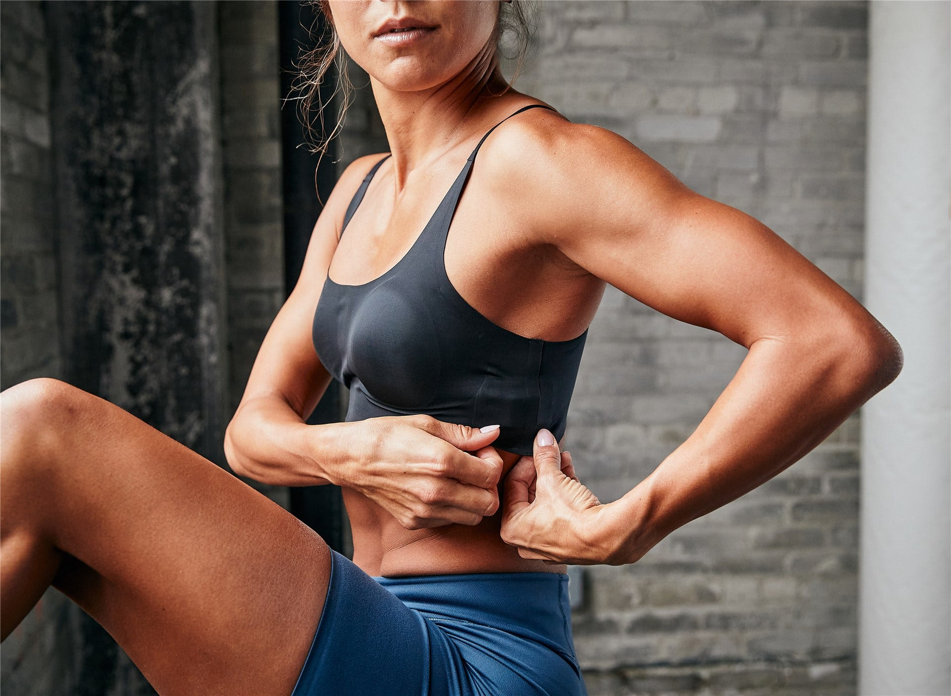 A woman wearing the Whoop Body sportsbra